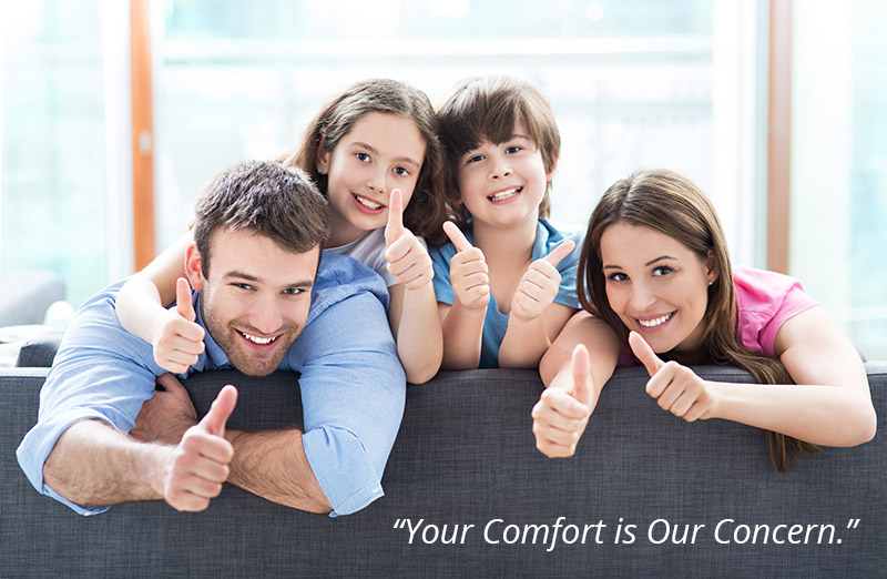 Estes Heating & Air Conditioning family giving thumbs up